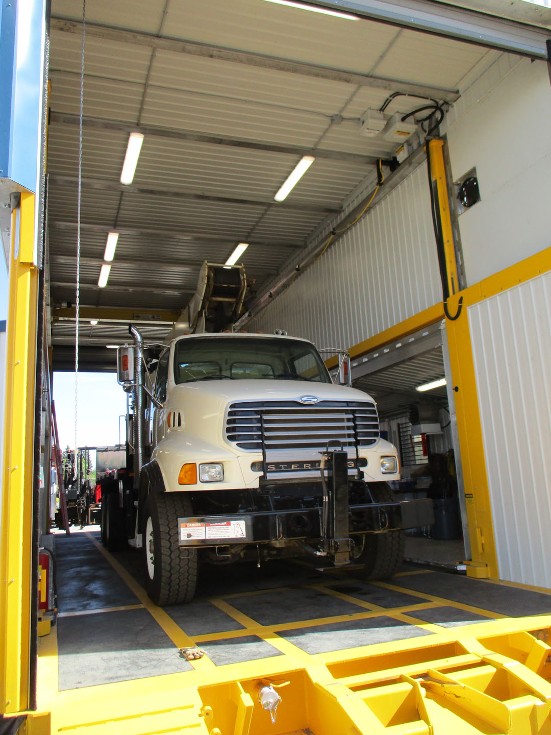 extreme portable buildings trans4mer truck entering auto wash bay thumbnail